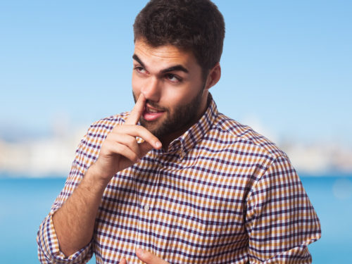 portrait of a young man with the finger into his nose Designed by asier_relampagoestudio / Freepik