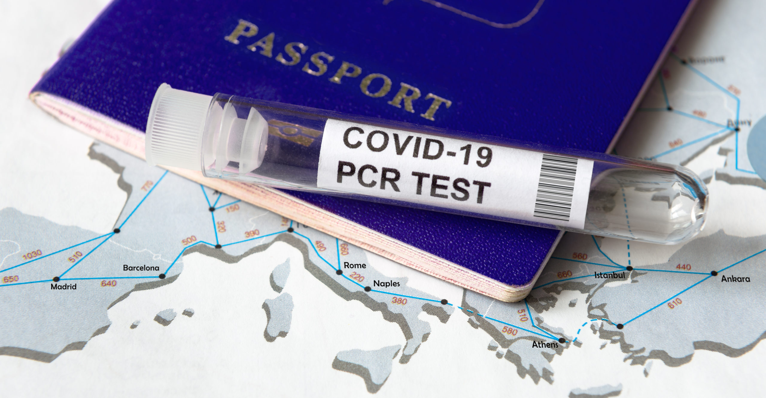 COVID-19, travel and test concept, tube for coronavirus PCR testing and tourist passport on Europe map. Coronavirus diagnostics in airport due to restrictions and lockdown. Tourism hit by corona virus